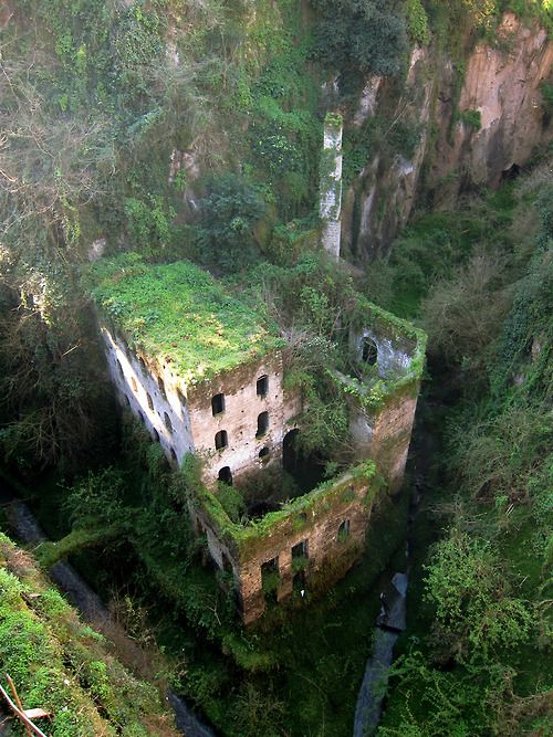 Abandoned mill in Sorrento, Italy >. I have actually been here, at night it lights up with different colors and it just glows!