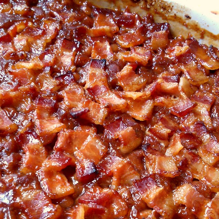 Southern Style Baked Beans Recipe Side Dishes with pork and beans, ketchup, barbecue sauce, brown sugar, yellow mustard, worcestershire sauce, liquid smoke, garlic powder, pepper, thick-cut bacon