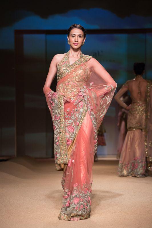 Ashima Leena pink gold floral sari. More here: http://www.indianweddingsite.com/bmw-india-bridal-fashion-week-ibfw-2014-ashima-leena/
