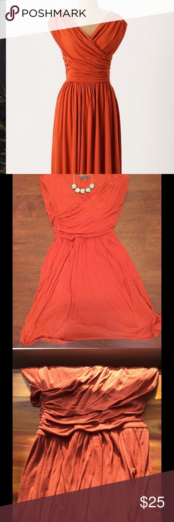"""🌷WEEKEND SALE🌷 Orange Whirligig Dress Beautiful faux-wrap burnt orange dress from Anthro, brand is Velvet. Comfortable and soft! Well loved with some pilling (See fourth photo for close up) but still very wearable. Stretchy with side ruching and cap sleeves. Approx 40in long shoulder to hem, hits at my knees and I'm 5'7"""". 50% rayon, 50% polyester. Offers welcome! Check out my bundle discounts! Anthropologie Dresses Midi"""