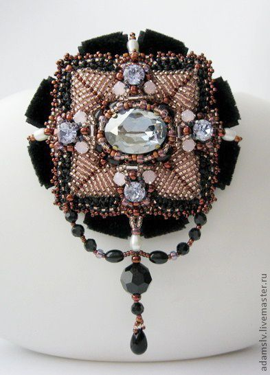 11 - Krisitina Adams is beadwork artist from Latvia. She makes amazing unusual bead embroidered brooches.