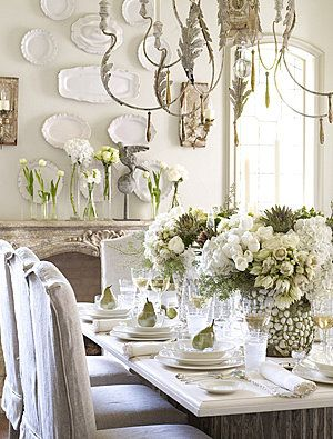 Lovingly decorated white dining space...