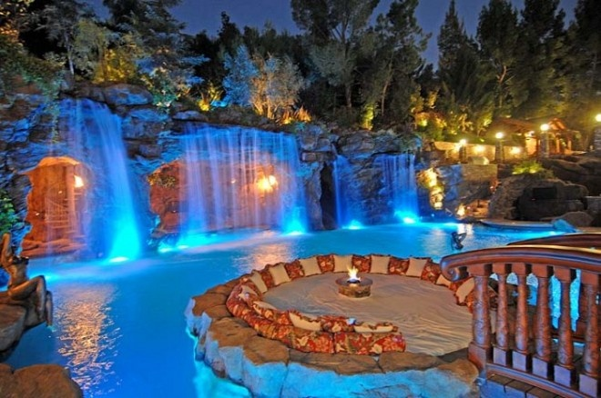 A backyard like this would be perfect in my dream home. I love how the lounging couch is in the center of this beautiful pool =)