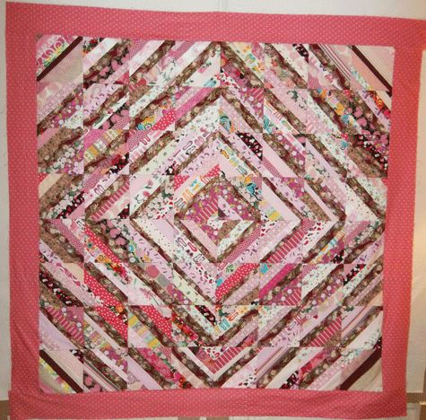 String-pieced quilt top from the pink part of QN creative editor Lori's stash.