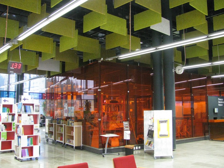 The entry to Entresse Library, Espoo, Finland. Note the coloured perspex hanging from the ceiling and the coloured glass or perspex enclosed rooms.