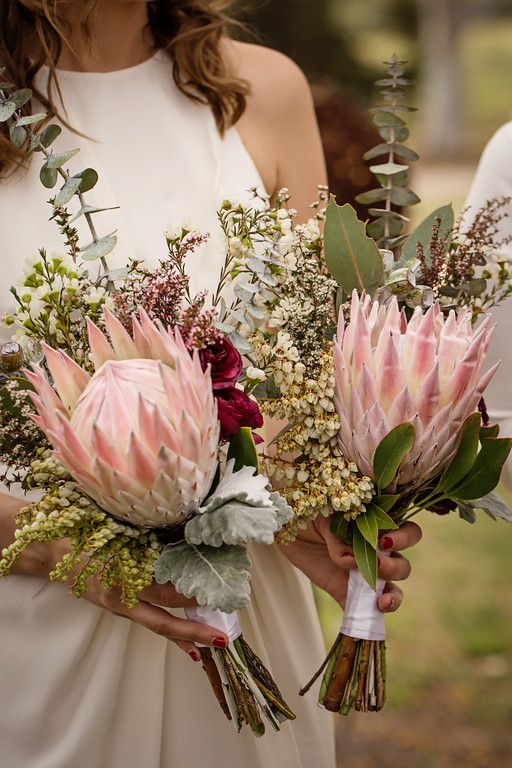 Em + Oliver's Bridesmaids king protea bouquets Photo: Anna Tenne