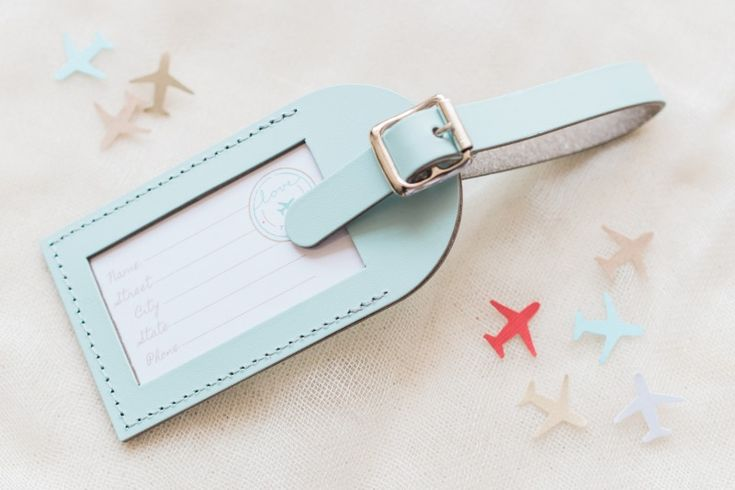 Luggage Tag Wedding Favors  See more here: http://www.lovetravelsfavors.com/