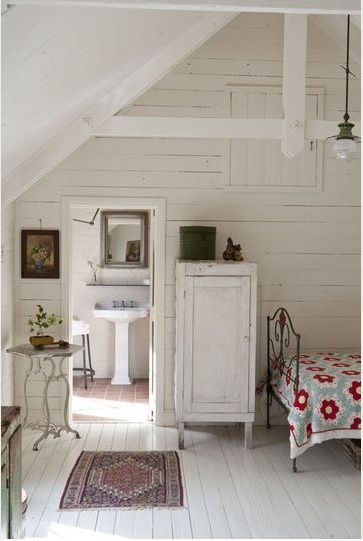 White shiplap in this rustic farmhouse room with country decor and red accents.