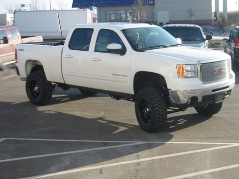 White lifted GMC Sierra Truck
