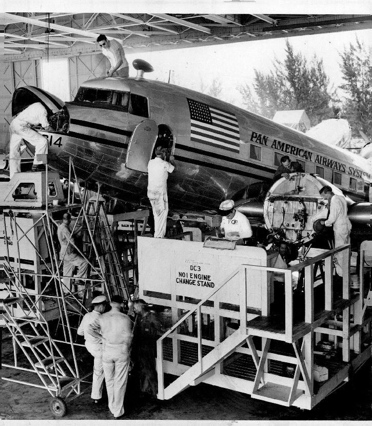 """We're number 1"" The Pan Am Douglas DC 3 Engine overhaul maintenance hanger Miami, circa 1942."