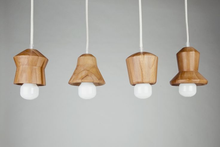 """KIRANA SET (4 LAMPS)  a set of pendants, which was developed out of traditional spinning-tops, called """"gasing"""". made out of turned solid teak"""