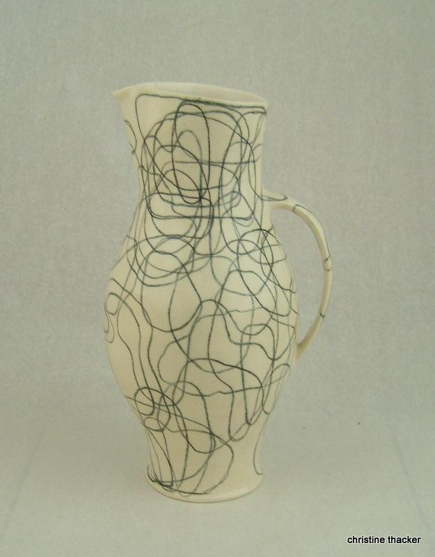 white earthenware and ceramic pencil