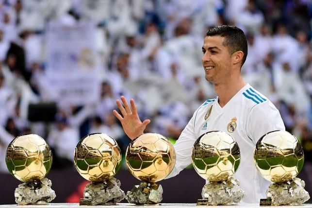 Real Madrid's Portuguese forward Cristiano Ronaldo poses with his five Ballon d'Or trophies ahead of the Spanish league football match between Real Madrid and Sevilla at the Santiago Bernabeu Stadium in Madrid on 9 December, 2017. Photo: AFP