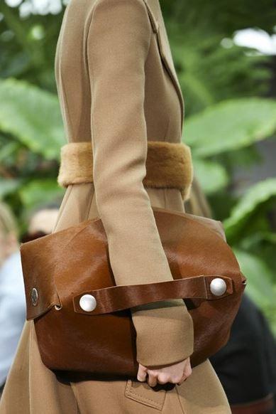 Celine fall 2015 - Camel coat and pony skin clutch bag detail