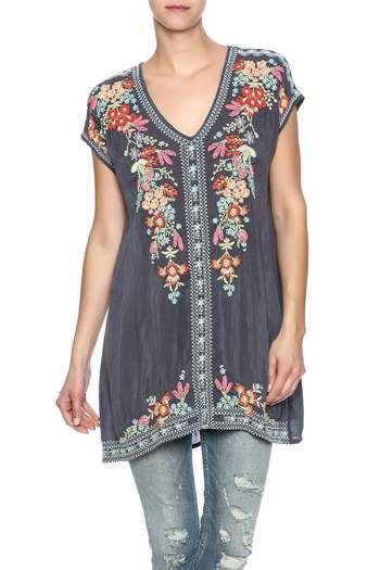Embroidered short sleeve tunic top with a v-neckline.