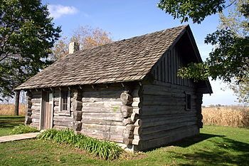 Little House Wayside (of Laura Ingalls Wilder fame) -- Pepin, WI -- Replica of the log cabin that Pa built in the big woods. The house sits in a corn field 7 miles out of Pepin. You step into the cabin and you can just imagine Ma cooking in the fireplace and Pa holding a little Laura!