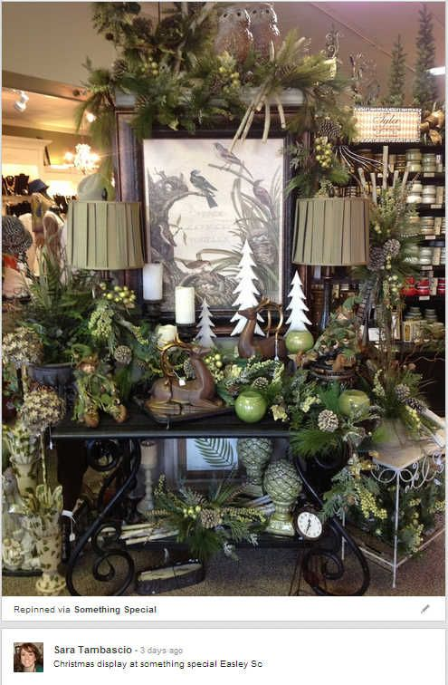 This beautiful display from Something Special gift store features a green and brown color scheme and shows off some high-end products along ...