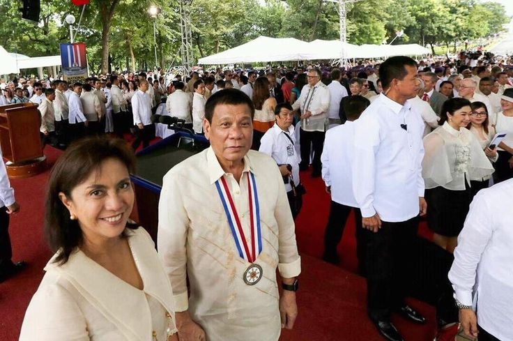 President Rodrigo Duterte and VP Leni Robredo isolates themselves for a cute photo op during the National Heroes Day event 2016.