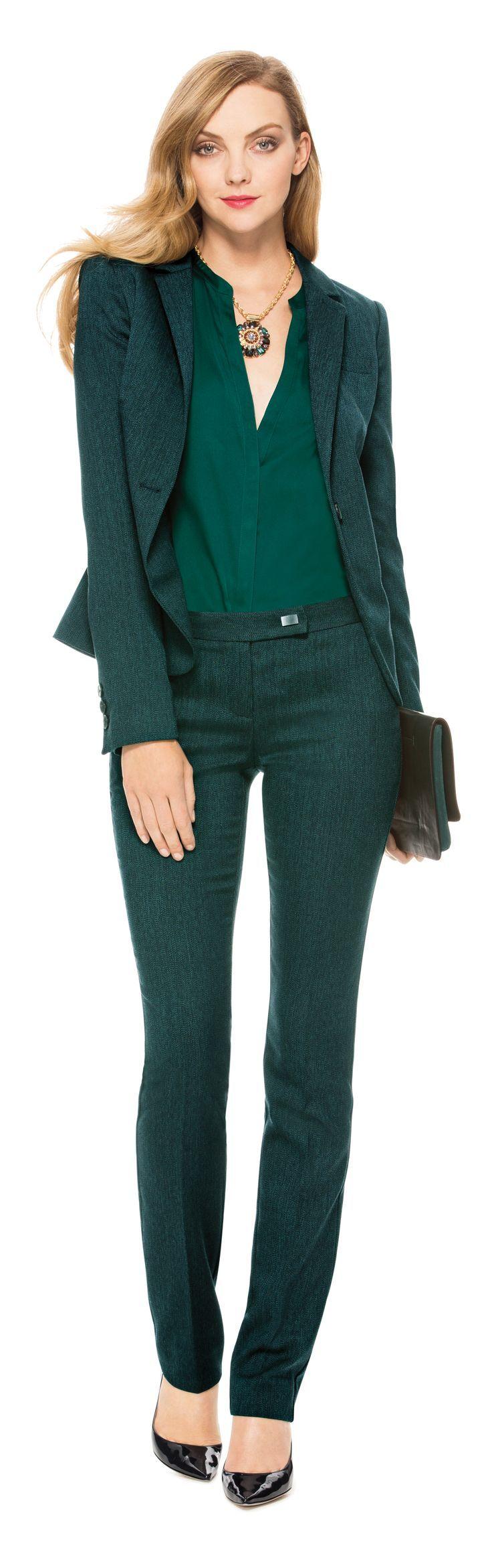 Fall / Winter - office wear - work outfit - deep green suit + emerald green silk v-neck blouse + black stilettos + black clutch