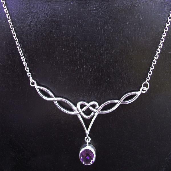"Amethyst necklace ""Eternal Love"" - Nyoman Rena has fused the luster and sheen of amethyst stone entwined in silver symbols of everlasting love."