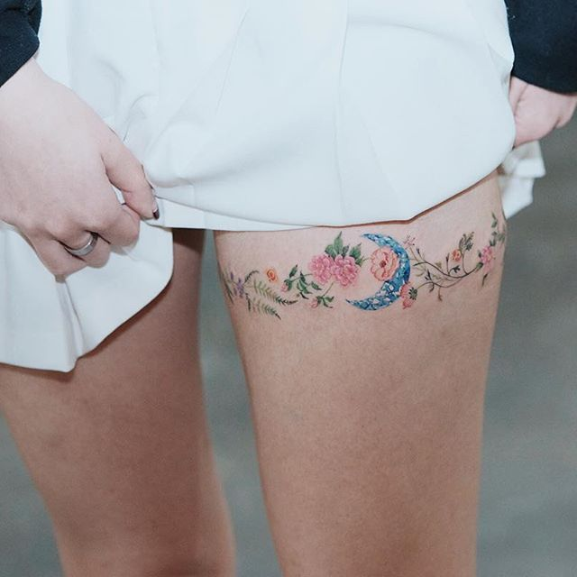 Tattoo artist - moons and flowers .