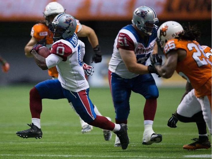 WK 9 Mtl.23 - BC 13 - Montreal Alouettes' Stefan Logan rushes for a first down against the B.C. Lions during the first half of a CFL football game in Vancouver, B.C., on Thursday August 20, 2015.