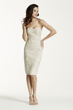 Prepare to truly shine on your big day in this glamorous beaded lace applique organza sheath dress!  LIMITED EDITION: Coveted Bridal Styles, available for a limited time.  Stunning allover-beaded lace appliques with lattice detail and flattering sweetheart neckline.  Breathtaking illusion cage-back detail.  Sizes 0-14. Available in select stores and online in Ivory/Champagne.  Back zip closure. Imported. Dry clean only. To preserve your wedding dreams, try our Wedding Gown Preservation Kit.