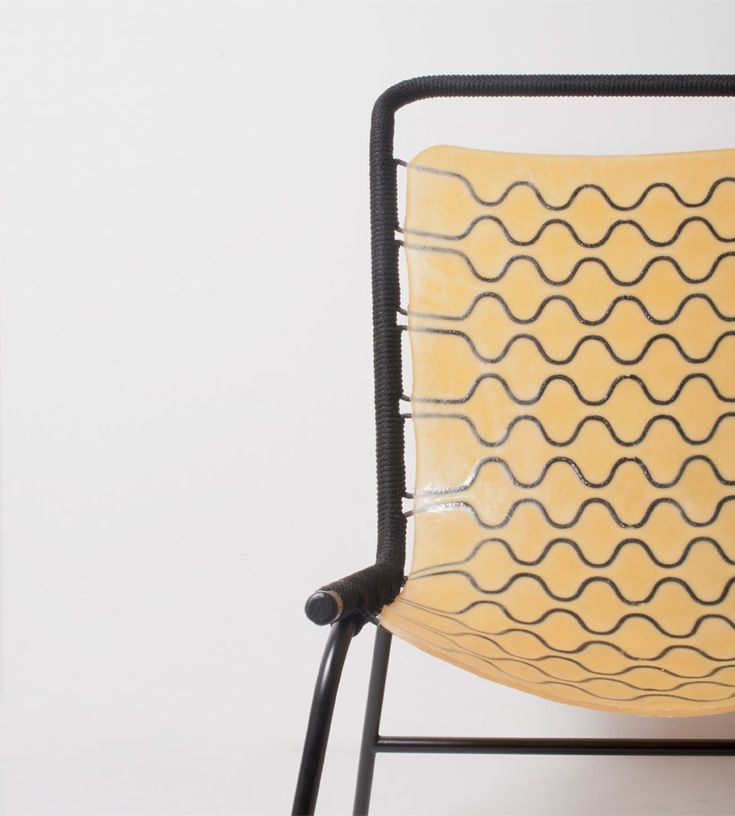hiroyuki morita tests elasticity of latex chair at IMM cologne 2018