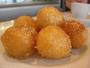 GREECE: Loukoumades - fried-dough pastry made of deep fried dough soaked in sugar syrup or honey and cinnamon, and sometimes sprinkled with sesame.
