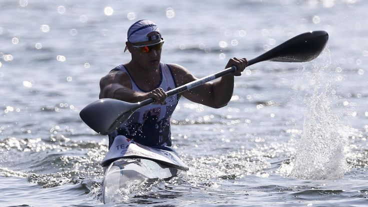 Great Britain's Liam Heath sprints to gold in the 200m kayak