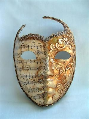 Venetian Mask...would love to decorate with these but I have a feeling these would start to creep me out after awhile lol
