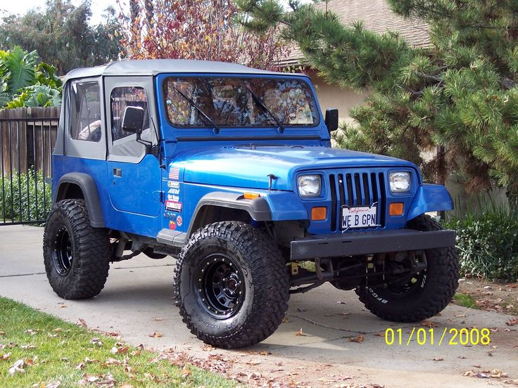Marshall's, now Aiden's, 1993 Jeep Wrangler (I love the American flag sticker - so Marshall)