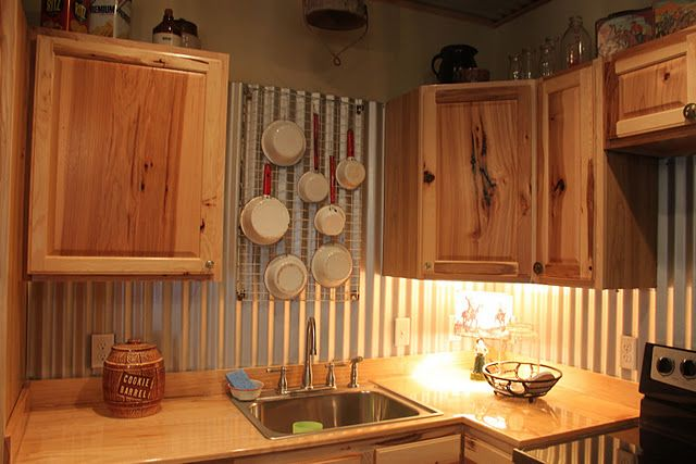 Corrugated tin back splash love the pot holder too for What kind of paint to use on kitchen cabinets for metal wall art designs