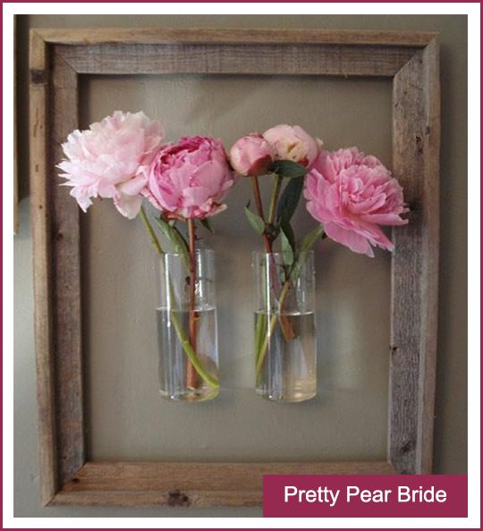 Great way to display your gorgeous blooms in a unique way.  From prettypearbride.com.