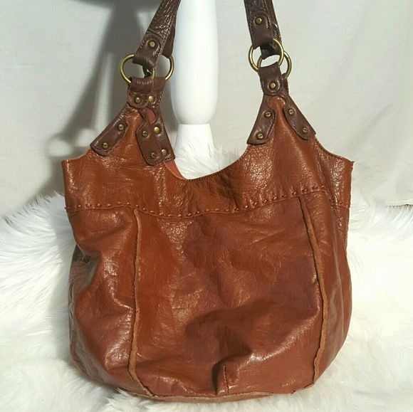 Shop Women's The Sak Tan Brown size OS Hobos at a discounted price at Poshmark. Description: The SAK distressed leather bucket slouch bag, excellent condition, no observed marks or nicks. 3 Internal sections - middle one is zippered. Has one other zipped section and 2 slots.  Measurements are approximate  15 inches wide x 9 inches high x 9 inches depth Shoulder strap drop 11 inches. Sold by beyourown. Fast delivery, full service customer support.