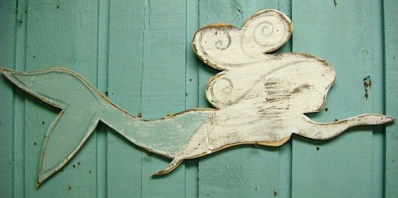 Recycled pywood mermaid.