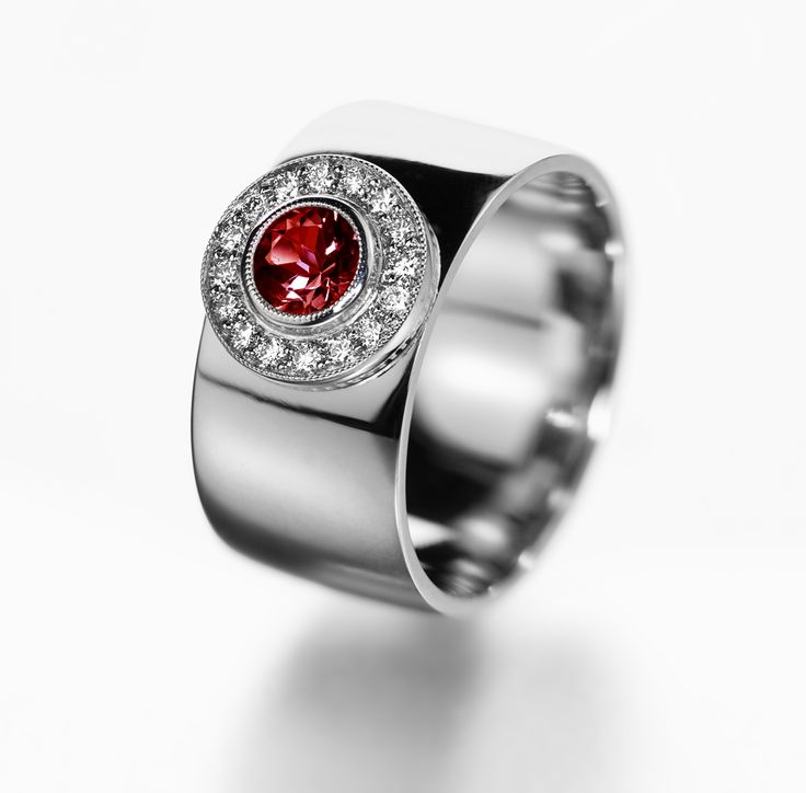 Halo engagement ring with red gemstone.