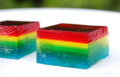 Rainbow Jello.  You only have to make red, yellow, and blue -- it just looks like there's orange and green.