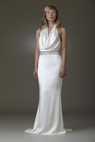 Amy Kuschel Farrahhas dramatic cowl neckline and striking open back highlight the elegant sex appeal of this Silk Charmeuse, sheath silhouette gown. This gown came from a bride and is brand new. Amy Kuschel Farrah is Ivory and a size 2.