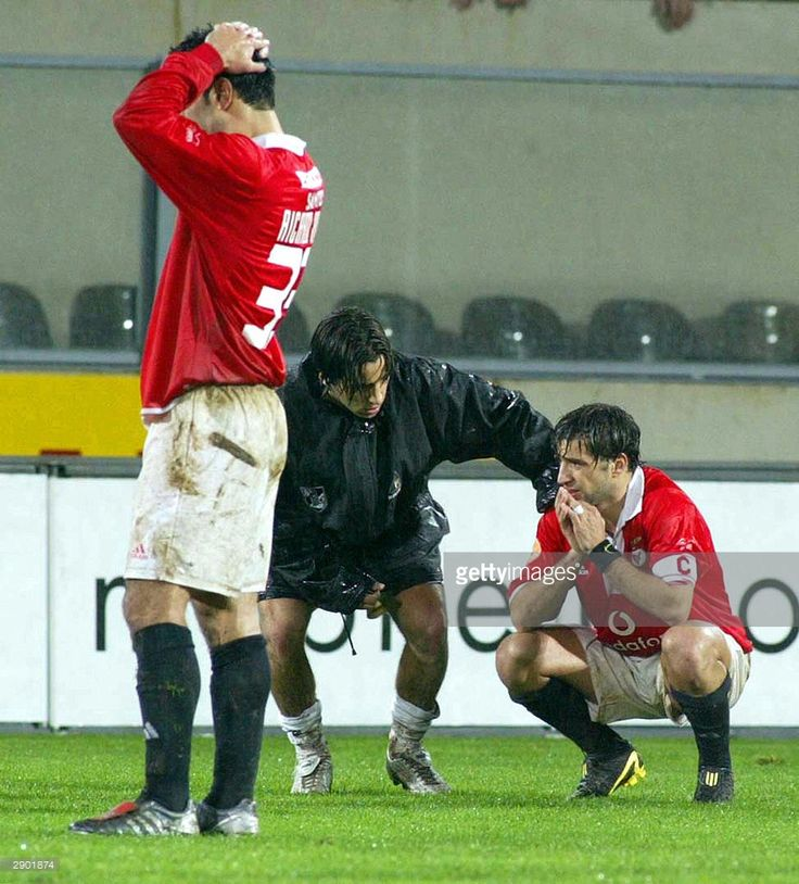 Benfica Ricardo Rocha (L), Guimaraes Nuno Assis (C) and Simao Sabrosa (R) comfort eachother after Benfica's Hungarian soccer striker Miklos Feher (down) during the Portuguese Premier League match held at Guimaraes stadium 25 January 2004. Hungarian striker Mikos Feher became the second international footballer in the last seven months to die during a game when he collapsed after being yellow-carded while playing for Benfica. The 24-year-old Feher, who had come on as a substitute after 60…