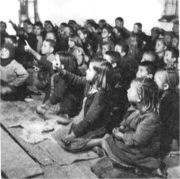 Greek Civil War - School photo taken in #Greece, probably in #Macedonia in the north where the Communist insurgency was the strongest. Here the insurgents could be supplied from bases in Yugoslavia and Bulgaria. Thus the fighting & resulting destruction was the the most intense in the north. Photograph was probably taken about 1949-50, just after the end of the Covil War. It shows the consequences of the war. The children had no shoes even though it was wintertime. And the school had no…