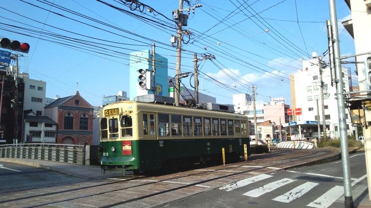 Nagasaki streetcar passes near the Yorozuya town.