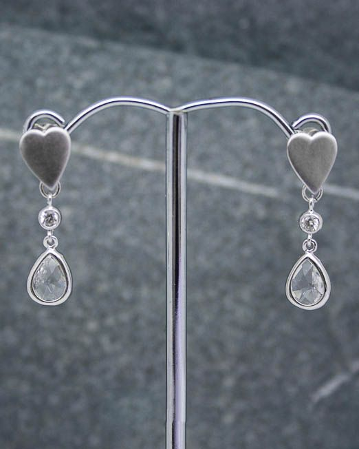 Heart and crystal drop earrings.  The heart measures 8mm x 10mm and the crystal drop 7mm x 9mm making a total length of 22mm approx.  They are set into rhodium plated fittings with 925 silver posts and scrolls.  #Crystal #Earrings #Heart #Portside