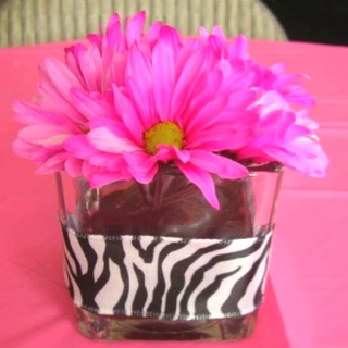 Zebra & hot pink centerpiece ideas......maybe just simple black with hot pink flowers??