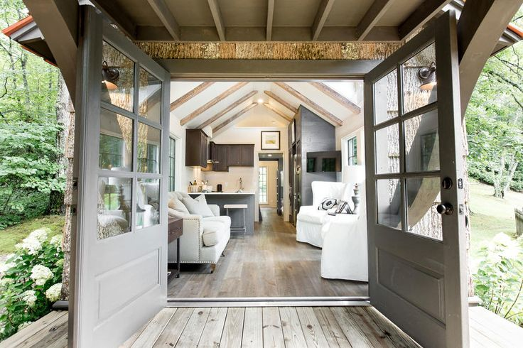 The Entrance - We Just Found the Tiny House of Your Dreams - Southernliving. Don't let the double French doors fool you, the house is only 12 ½ feet wide by 12 feet tall in order to allow for travel on roads and under bridges.