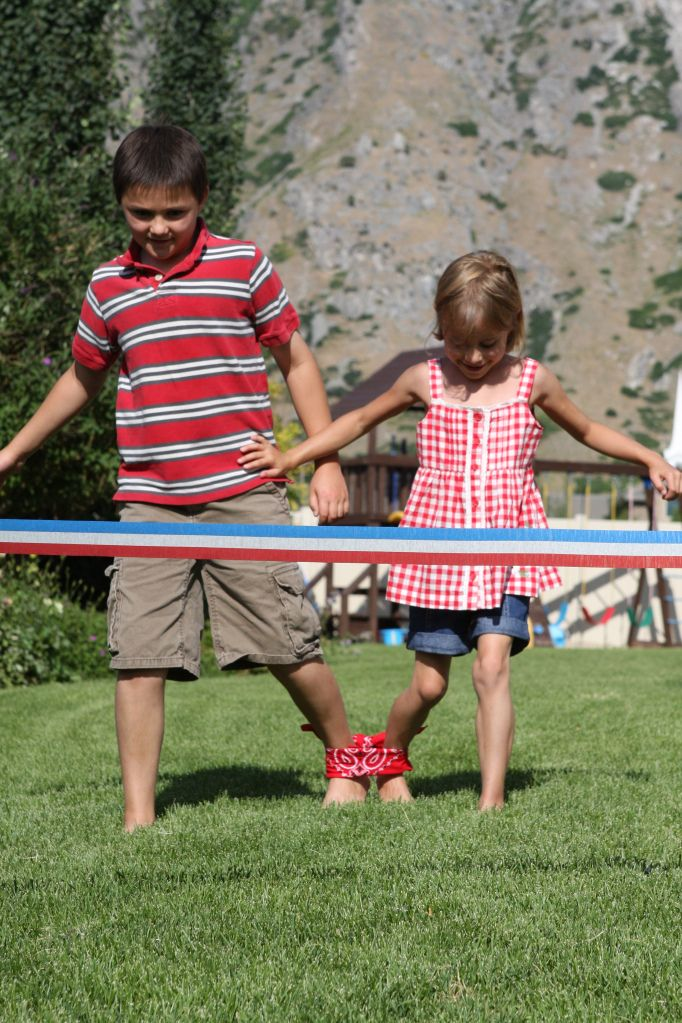 how about a three legged race! fun and inexpensive! great source for games and activities for your Fourth of July cookout!