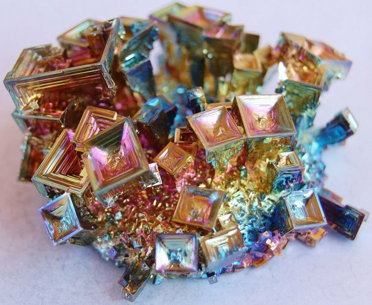BISMUTH:  It does not crystallize naturally,there is not enough space for its crystals to form properly. With a little help from humans, it is melted and recrystallized into a beautiful iridescent rainbow form. Improves concentration/visualization, a stone of transformation, moving things from chaos to order. In addition, Bismuth has been known to promote cooperation in group situations and also in relationships.