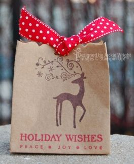Perfect for Christmas for cookies/gifts. Cut off the top of a paper lunch sack with decorative scissors, stamp your message, tie with ribbon. Cute!