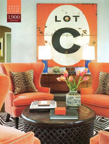A warm orange is one of my favorite accent colors.  It lives easier the say red a (color most people get wrong).  It adds warmth and pop and looks great on traditional furniture shapes.  Here the abundance of it set off by the killer (primitive-mod) graphic element really works. Note chairs clustered around a coffee table are far more versatile then sofas.