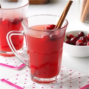 Slow Cooker Christmas Punch Recipe- Recipes  Simmer down with a warm pineapple punch made in the slow cooker. We use cinnamon and Red Hots to give it that cozy spiced flavor and welcome-home aroma. —Angie Goins, Tazewell, TN